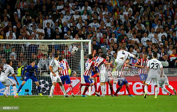 Sergio Ramos of Real Madrid heads in their first goal during the UEFA Champions League Final between Real Madrid and Atletico de Madrid at Estadio da...