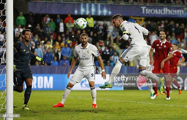 Sergio Ramos of Real Madrid heads the ball to scores his team's second goal during the UEFA Super Cup match between Real Madrid and Sevilla at...