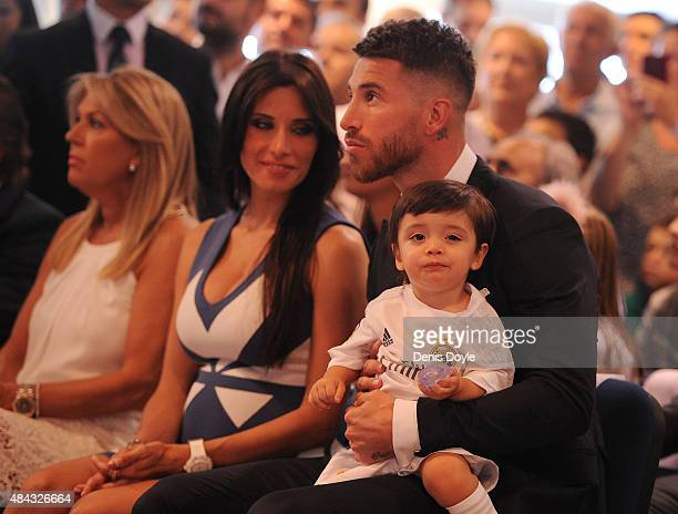 Sergio Ramos of Real Madrid holds his son Sergio Junior Ramos along with his wife Pilar Rubio during a press conference to announce his new fiveyear...