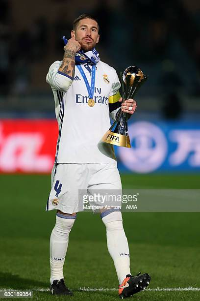 Sergio Ramos of Real Madrid holds the trophy at the end of the FIFA Club World Cup final match between Real Madrid and Kashima Antlers at...