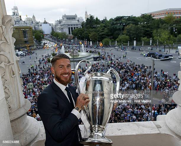 Sergio Ramos of Real Madrid holds the trophy during Real Madrid CF team celebration in Madrid town hall on May 29 2016 in Madrid Spain