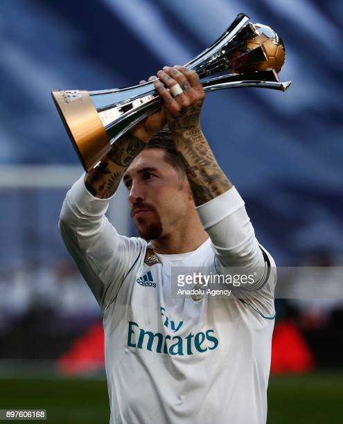 Sergio Ramos of Real Madrid holds the trophy of 2017 FIFA Club World Cup ahead of the La Liga match between Real Madrid and Barcelona at Santiago...