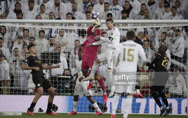 Sergio Ramos of Real Madrid in action against Ederson of Manchester City during the UEFA Champions League round of 16 first leg soccer match between...