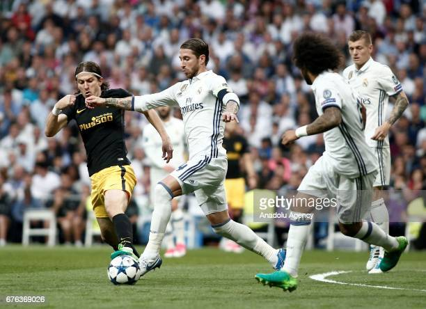 Sergio Ramos of Real Madrid in action against Filipe Luis of Atletico Madrid during UEFA Champions League semi final match between Real Madrid and...