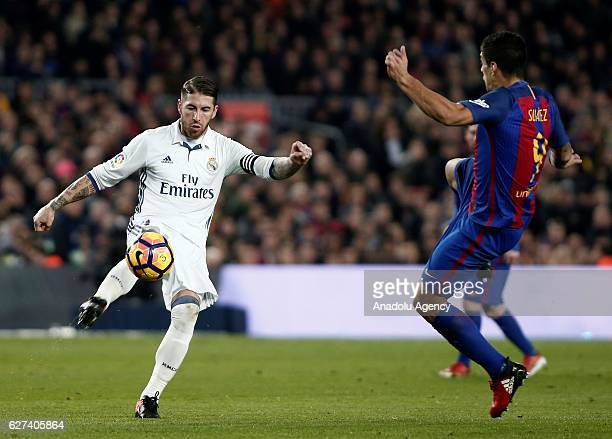 Sergio Ramos of Real Madrid in action against Luis Suarez of Barcelona during the La Liga football match between FC Barcelona and Real Madrid CF at...