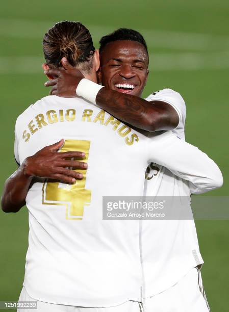 Sergio Ramos of Real Madrid is congratulated by team mate Vinícius Júnior after scoring his sides second goal during the Liga match between Real...