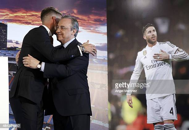 Sergio Ramos of Real Madrid is embraced by Real president Florentino Perez during a press conference to announce Ramos' new fiveyear contract with...