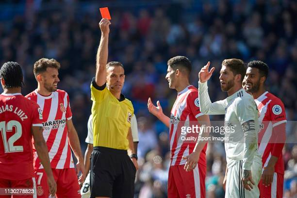 Sergio Ramos of Real Madrid is shown a red card by referee during the La Liga match between Real Madrid CF and Girona FC at Estadio Santiago Bernabeu...