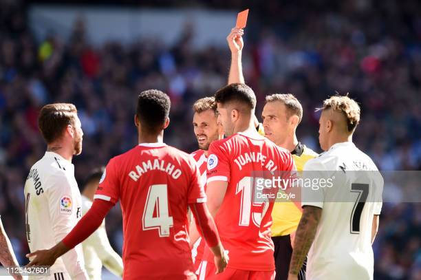 Sergio Ramos of Real Madrid is shown a red card by referee Santiago Bernabeu during the La Liga match between Real Madrid CF and Girona FC at Estadio...