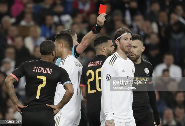Sergio Ramos of Real Madrid is shown red card during the UEFA Champions League round of 16 first leg soccer match between Real Madrid and Manchester...