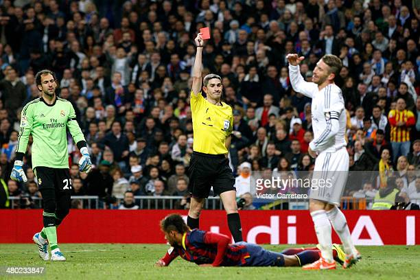 Sergio Ramos of Real Madrid is shown the red card by referee Alberto Undiano Mallenco during the La Liga match between Real Madrid and FC Barcelona...