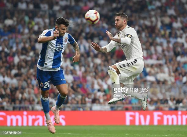 Sergio Ramos of Real Madrid is tackled by Mario Hermoso of RCD Espanyol during the La Liga match between Real Madrid CF and RCD Espanyol at Estadio...