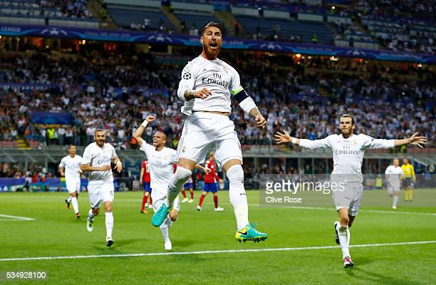 Sergio Ramos of Real Madrid jumps in the air in celebration after scoiring the opening goal during the UEFA Champions League Final match between Real...