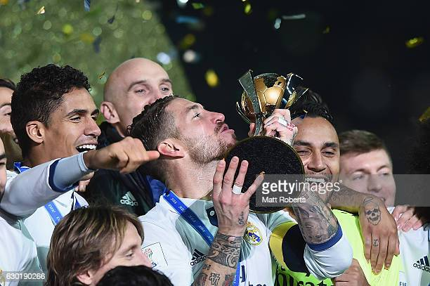 Sergio Ramos of Real Madrid kisses the trophy as Real Madrid celebrate victory during the FIFA Club World Cup final match between Real Madrid and...