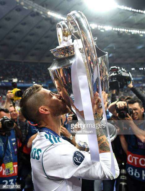 Sergio Ramos of Real Madrid kisses the UEFA Champions League Trophy following his sides victory in the UEFA Champions League Final between Real...