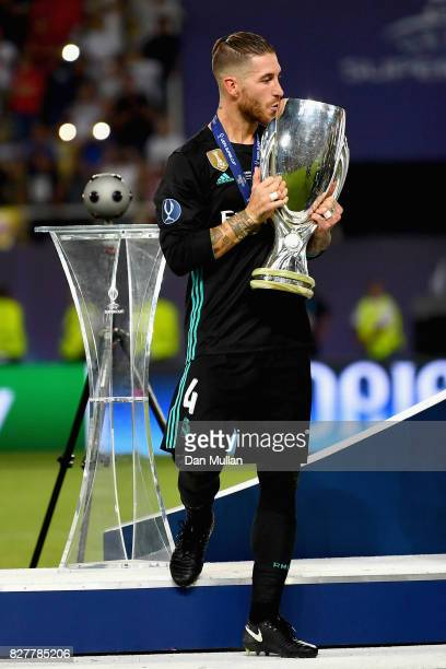 Sergio Ramos of Real Madrid kisses the UEFA Super Cup after the UEFA Super Cup final between Real Madrid and Manchester United at the Philip II Arena...