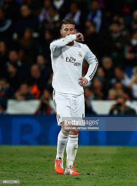 Sergio Ramos of Real Madrid leaves the field after being shown the red card during the La Liga match between Real Madrid CF and FC Barcelona at the...