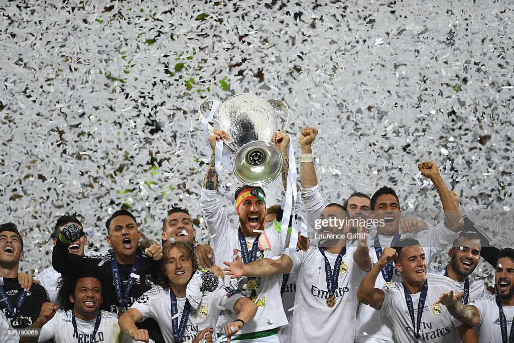 Sergio Ramos of Real Madrid lifts the Champions League trophy after victory in the UEFA Champions League Final match between Real Madrid and Club Atletico de Madrid at Stadio Giuseppe Meazza on May 28, 2016 in Milan, Italy.