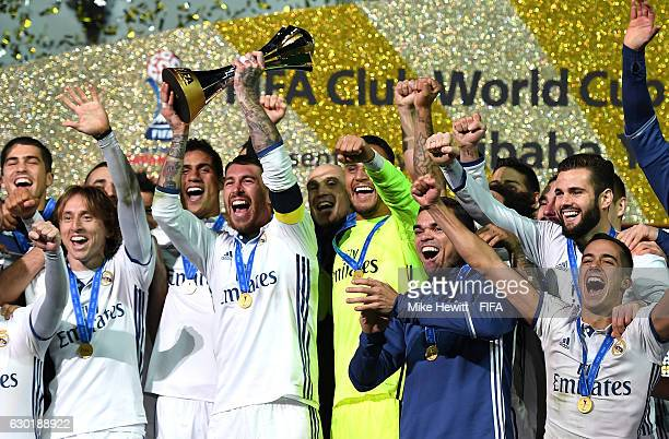 Sergio Ramos of Real Madrid lifts the trophy as him and his team mates celebrate victory following the FIFA Club World Cup Final match between Real...