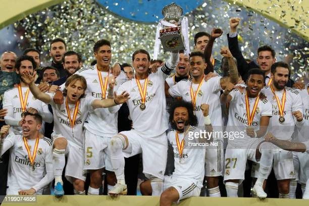 Sergio Ramos of Real Madrid lifts the trophy with his team after his teams victory in the Supercopa de Espana Final match between Real Madrid and...