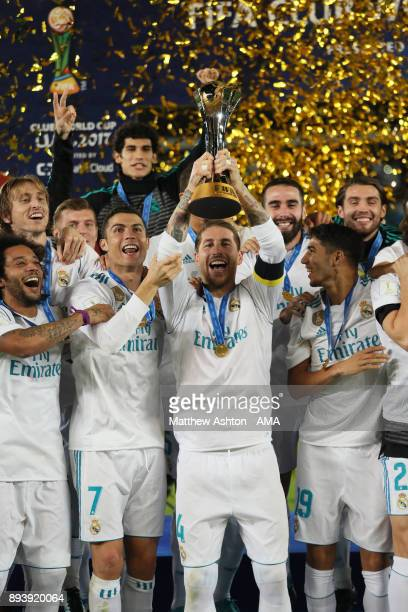 Sergio Ramos of Real Madrid lifts the trophy with his teammates at the end of the FIFA Club World Cup UAE 2017 final match between Gremio and Real...
