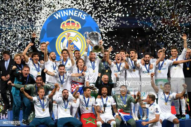 Sergio Ramos of Real Madrid lifts The UEFA Champions League trophy following their side's victory in the UEFA Champions League Final between Real...