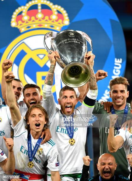 Sergio Ramos of Real Madrid lifts The UEFA Champions League trophy following his sides victory in the UEFA Champions League Final between Real Madrid...