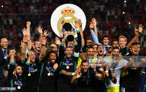 Sergio Ramos of Real Madrid lifts The UEFA Super Cup trophy after the UEFA Super Cup final between Real Madrid and Manchester United at the Philip II...
