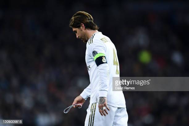 Sergio Ramos of Real Madrid looks dejected as he leaves the pitch after receiving a red card during the UEFA Champions League round of 16 first leg...