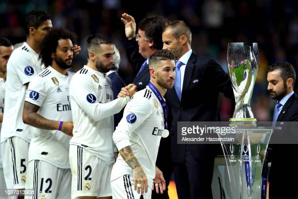 Sergio Ramos of Real Madrid looks dejected as he walks past the trophy following the UEFA Super Cup between Real Madrid and Atletico Madrid at...