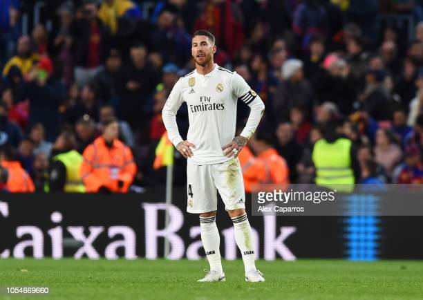 Sergio Ramos of Real Madrid looks dejected as Luis Suarez of Barcelona scores his sides third goal during the La Liga match between FC Barcelona and...