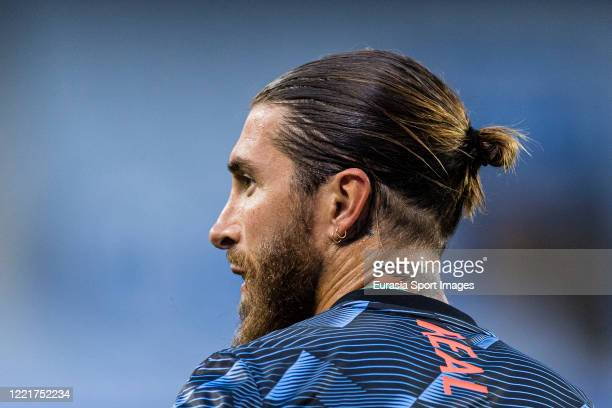 Sergio Ramos of Real Madrid looks on as warming up before the Liga match between Real Sociedad and Real Madrid CF at Estadio Anoeta on June 21, 2020...