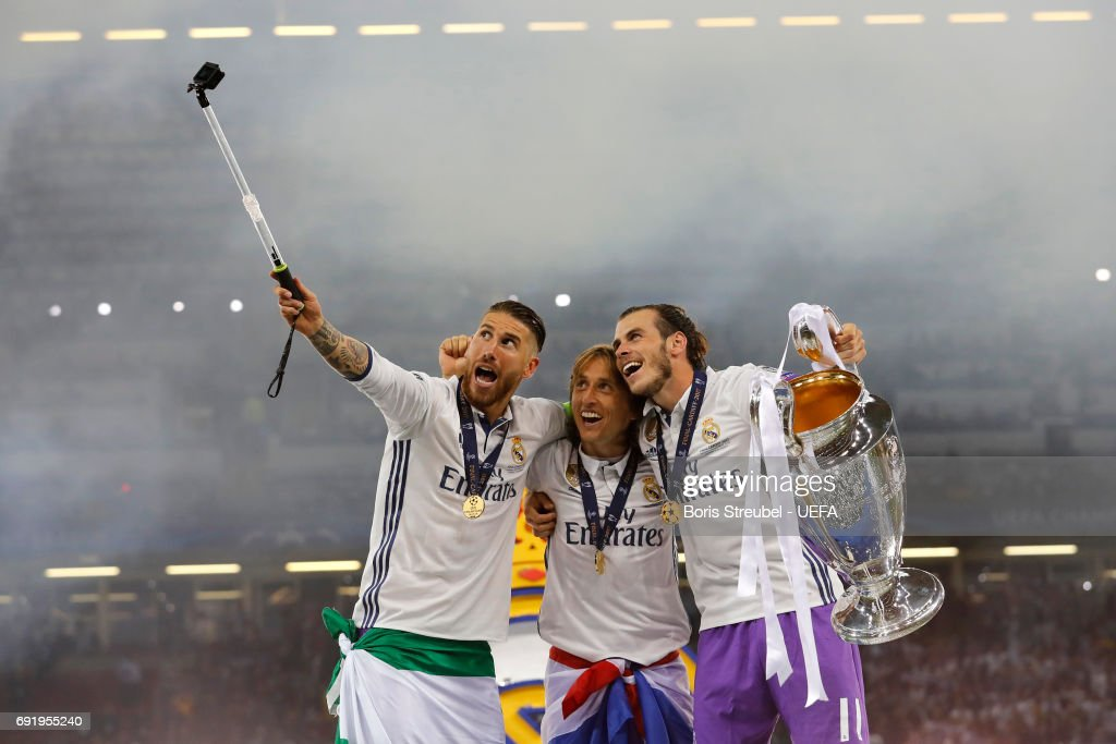 Sergio Ramos of Real Madrid Luka Modric of Real Madrid and Gareth Bale of Real Madrid take a selfie with the Champions League trophy during the UEFA Champions League Final between Juventus and Real Madrid at National Stadium of Wales on June 3, 2017 in Cardiff, Wales.