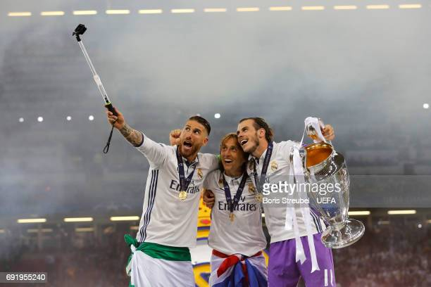 Sergio Ramos of Real Madrid Luka Modric of Real Madrid and Gareth Bale of Real Madrid take a selfie with the Champions League trophy during the UEFA...