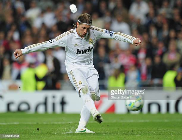 Sergio Ramos of Real Madrid misses his penalty during the UEFA Champions League second leg semi-final match between Real Madrid and Bayern Munich at...
