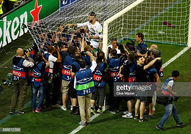 Sergio Ramos of Real Madrid of Real Madrid cuts the net after the UEFA Champions League Final match between Real Madrid and Club Atletico de Madrid...