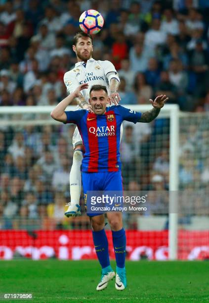 Sergio Ramos of Real Madrid outjumps Paco Alcacer of Barcelona during the La Liga match between Real Madrid CF and FC Barcelona at Estadio Bernabeu...