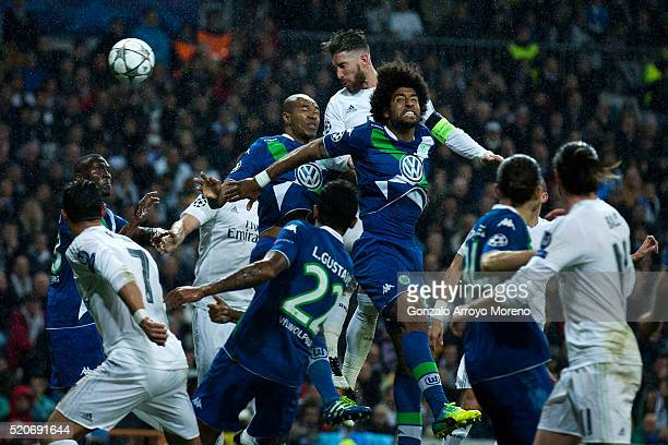 Sergio Ramos of Real Madrid outjumps the Wolfsburg defence during the UEFA Champions League quarter final second leg match between Real Madrid CF and...