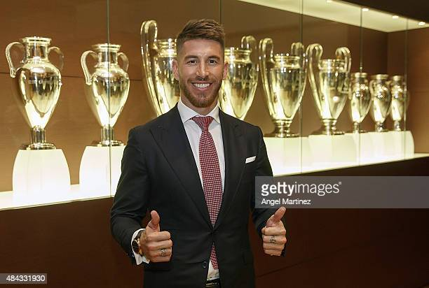 Sergio Ramos of Real Madrid poses after signs his new fiveyear contract at the Santiago Bernabeu stadium on August 17 2015 in Madrid Spain