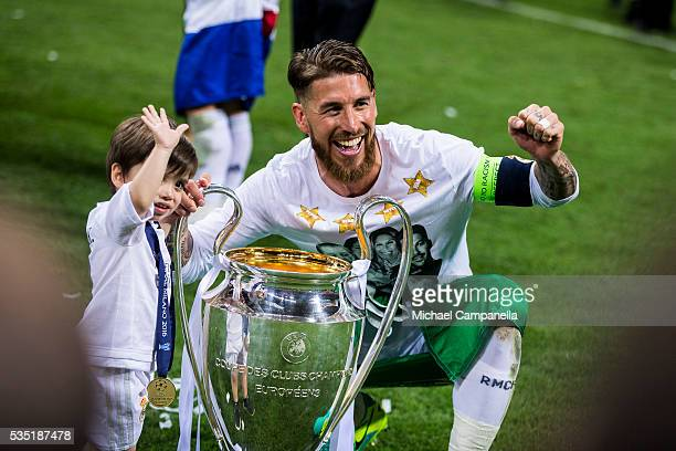 Sergio Ramos of Real Madrid poses for a photo with his son during the UEFA Champions League Final between Real Madrid and Atletico Madrid at Stadio...