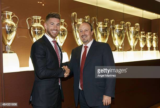 Sergio Ramos of Real Madrid poses with head coach Rafael Benitez after signs his new fiveyear contract at the Santiago Bernabeu stadium on August 17...