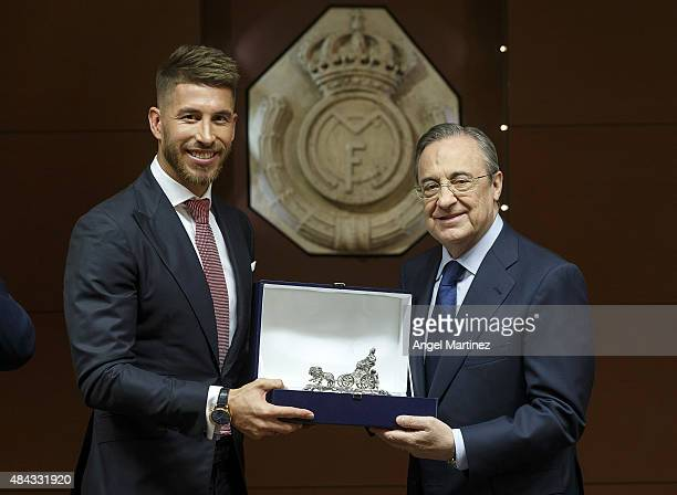Sergio Ramos of Real Madrid poses with Real president Florentino Perez after signs his new fiveyear contract at the Santiago Bernabeu stadium on...