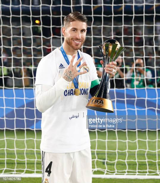 Sergio Ramos of Real Madrid poses with the trophy after the match between Real Madrid and Al Ain on December 22 2018 in Abu Dhabi United Arab Emirates
