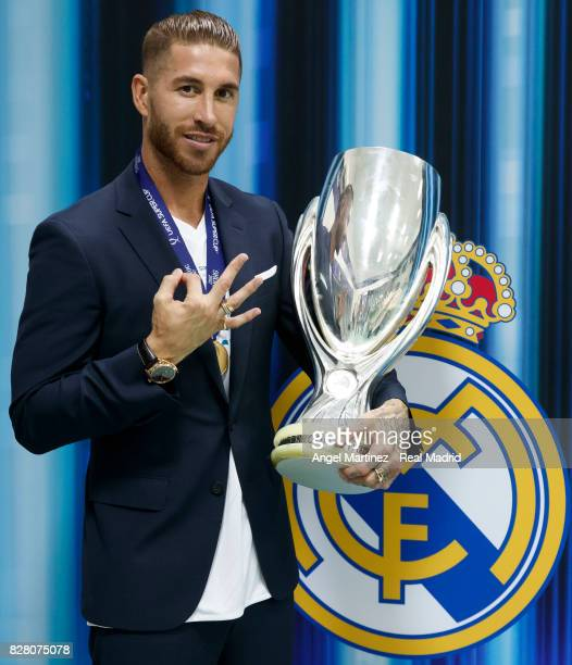 Sergio Ramos of Real Madrid poses with the trophy after the UEFA Super Cup match between Real Madrid and Manchester United at Philip II Arena on...