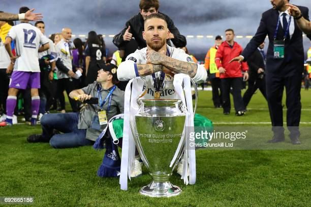 Sergio Ramos of Real Madrid poses with the trophy following the UEFA Champions League Final match between Juventus and Real Madrid at the National...