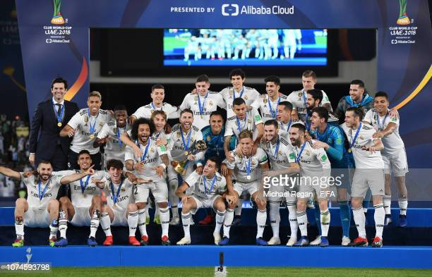 Sergio Ramos of Real Madrid prepares to lift the FIFA Club World Cup trophy following the FIFA Club World Cup UAE 2018 Final between Al Ain and Real...