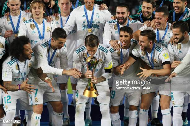 Sergio Ramos of Real Madrid prepares to lift the trophy with his teammates at the end of the FIFA Club World Cup UAE 2017 final match between Gremio...