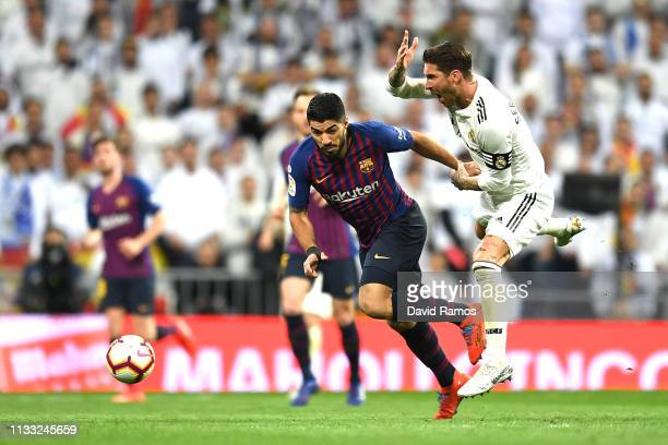 Sergio Ramos of Real Madrid pulls back Luis Suarez of Barcelona during the La Liga match between Real Madrid CF and FC Barcelona at Estadio Santiago...