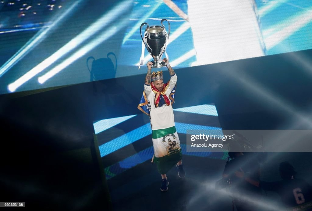Sergio Ramos Of Real Madrid Raises The UEFA Champions League Trophy During Celebrations At Santiago Bernabeu