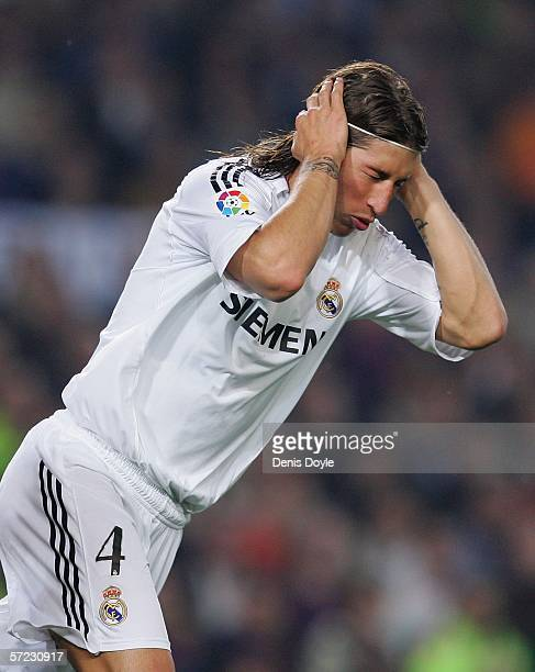 Sergio Ramos of Real Madrid reacts after missing a goal scoring opportunity during a Primera Liga match between Barcelona and Real Madrid at the Camp...